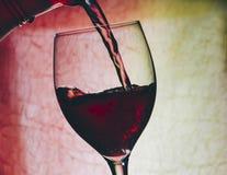 Vin rouge en glace photo stock