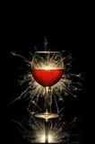 Vin rouge et feu d'artifice rougeoyants Photographie stock