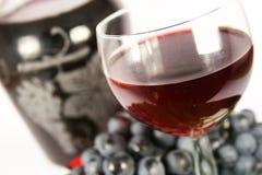 Vin rouge et raisin en verre Image libre de droits