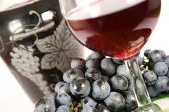 Vin rouge et raisin en verre Images libres de droits