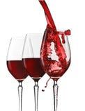 Vin rouge pleuvant à torrents Photos stock