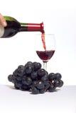Vin rouge pleuvant à torrents Images libres de droits