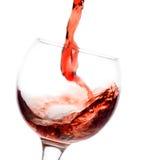 Vin rouge pleuvant à torrents vers le bas Image libre de droits