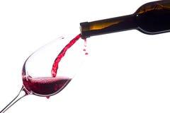 Vin rouge sur le fond blanc photos stock