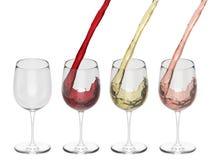 Vin som häller in i exponeringsglas - uppsättning Arkivbild