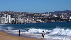 Vina del Mar, Chile - 2019-07-28 - young couple wanders into the surf.  stock video