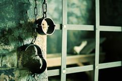 Metal shackles in old prison royalty free stock images