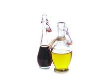 Vinagre balsâmico e petróleo verde-oliva Fotografia de Stock Royalty Free