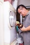 Vinaigre de cidre d'Apple pour enlever l'odeur du dessiccateur de machine à laver image libre de droits