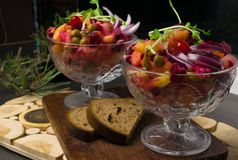 The vinaigrette beet salad. The vinaigrette salad with bread on the wood royalty free stock images