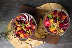 The vinaigrette beet salad. The vinaigrette salad with bread on the wood royalty free stock photo