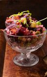 The vinaigrette beet salad. The vinaigrette salad with bread on the wood stock images