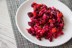 Vinaigrette with beetrot on plate. Vinaigrette - traditional russian salad with beetroot and cabbage Stock Image