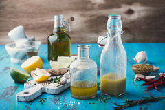 Vinaigrette and ingredients, salad dressing with oil, vinegar. Homemade vinaigrette and ingredients, salad dressing with oil, vinegar and mustard, rustic style royalty free stock image