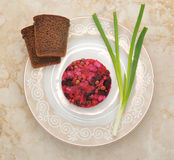 Vinaigrette on the plate with rye bread and green onions Royalty Free Stock Photos