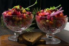 The vinaigrette beet salad. The vinaigrette salad with bread on the wood stock photos