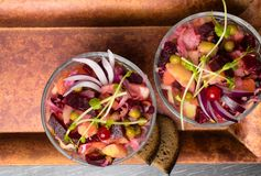 The vinaigrette beet salad. The vinaigrette salad with bread on the wood royalty free stock photography