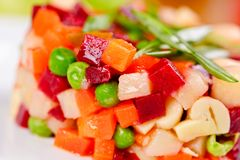 Vinaigrette. Traditional Russian cuisine. Salad with boiled beet root and vegetables on white plate. Close up stock photo
