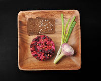 Vinaigrette on wooden plate with rye bread, salt and green onion Royalty Free Stock Photo