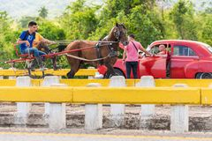 VINALES, CUBA - MAY 13, 2017: American red retro car on the track. Copy space for text. Royalty Free Stock Image