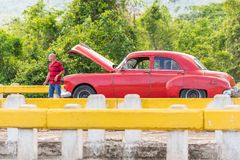 VINALES, CUBA - MAY 13, 2017: American red retro car on the track. Copy space for text. Royalty Free Stock Photos