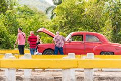 VINALES, CUBA - MAY 13, 2017: American red retro car on the track. Copy space for text. Stock Photography