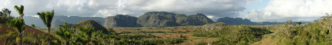 Vinales Panorama. Huge panoramic view of Vi�ales (20600 x 2800 px), a famous landscape in Cuba. The region is located in the north-central Pinar del Rio Stock Photography