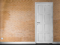 Vinatge brick wall and white door Royalty Free Stock Images