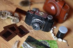 Vinatge camera with photos and souvenirs stock photography
