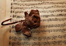 Vinatge sheet music. Vintage sheet music and stone rose Stock Photography