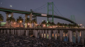 Vincent Thomas Bridge, Port of Los Angeles Time Lapse. Time laspe video of moon rising over the Vincent Thomas Bridge in the Port of Los Angeles stock video footage