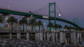 Vincent Thomas Bridge, Port of Los Angeles Time Lapse. Time laspe video of moon rising over the Vincent Thomas Bridge in the Port of Los Angeles stock video