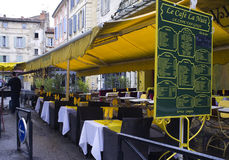 Vincent Van Gogh Cafe, Arles, France. Le Cafe La Nuit, with its menus sign, and  yellow awning and napkins, and white table cloths, is the cafe painted by Royalty Free Stock Images