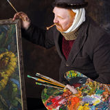 Vincent van Gogh portrait of dedication. Close-up portrait of the adult artist with red beard and mustache in the style of Vincent van Gogh studio on dark stock photo