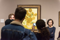Vincent van Gogh, Sunflower paintings. The inside of the National gallery of London. Tourist and art lovers are looking around at the artworks of Vincent van stock photography