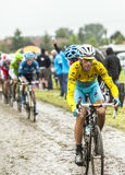 Vincenzo Nibali - Yellow Jersey on a Cobbled Road Stock Photos
