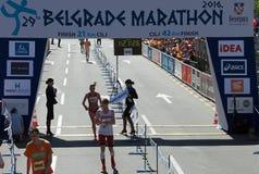 Vincitore della mezza maratona per la donna Fotografie Stock Libere da Diritti