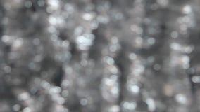Vind skakar bokeh från försilvrar glitter arkivfilmer