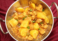 Vindaloo in a kadai. A vindaloo chicken and potato curry, cooked balti-style in a kadai (karahi) cooking pot, garnished with sliced chillis Royalty Free Stock Photos
