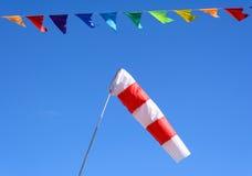 Vindkotte och färgade flaggor Royaltyfri Foto
