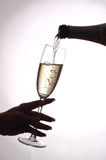 Vine. Pouring champagne in glass Royalty Free Stock Photography