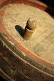 Vine barrel deck. Wooden vine barrel cover closeup Stock Photo