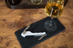Vine bottle opener on a roof slate Stock Photos