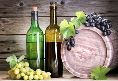 Vine. Bottle of vine on  wooden background Royalty Free Stock Photos