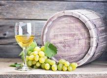 Vine. Bottle of vine on wooden background stock images