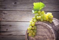 Vine. Bottle of vine on wooden background stock image
