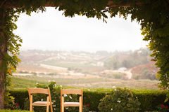 Vine Covered Patio and Chairs with View Royalty Free Stock Images