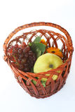 Vine and fruit in basket Stock Photo