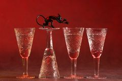 Vine-glases with devil. Four vine-glases with devil Stock Images