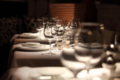 Vine glass atnosphere. Beautifully set table in a restaurant Stock Photos